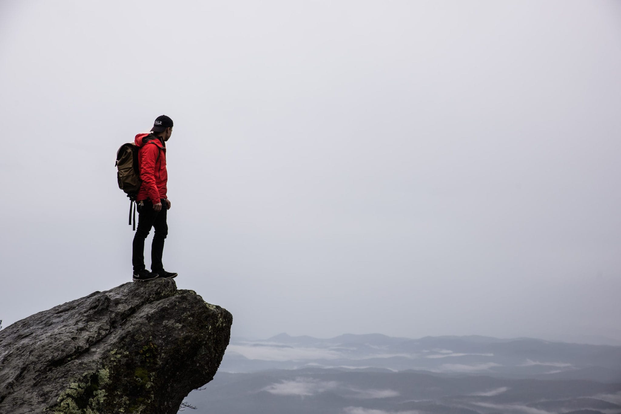 Young man who has hiked up a mountain