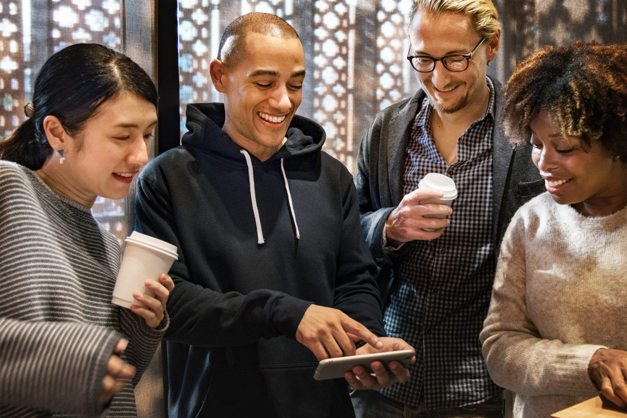Young people watching a video on a cell phone