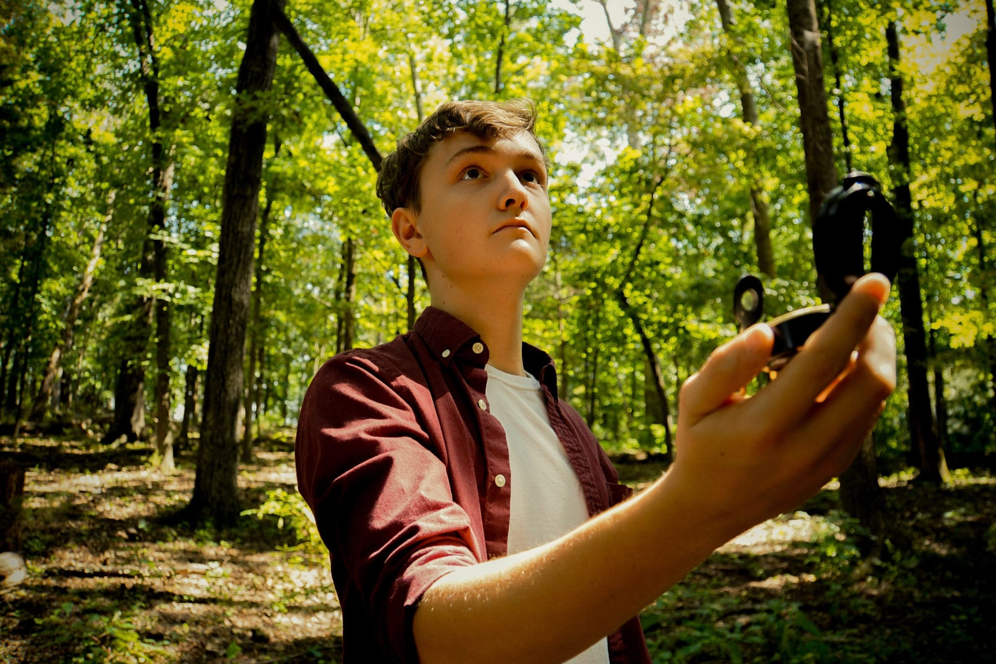 Young boy using a compass